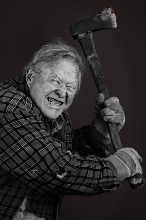 Very scary crazy old man with axe, great details, almost completely black and white except for eyes and blood on tool. photo