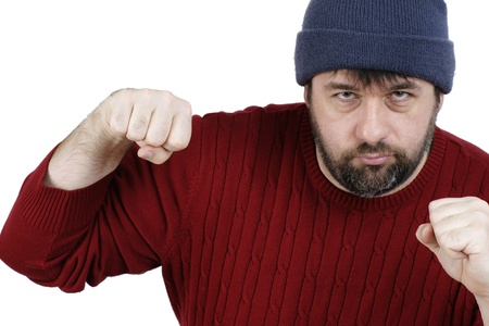 Large middle-age man with beard during a fist fight, ready to punch, isolated on white photo
