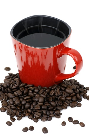 Handmade square red ceramic mug filled with hot black coffee with beans over white photo