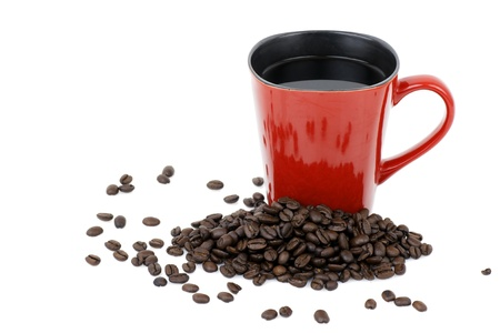 Handmade square red ceramic mug filled with hot black coffee with beans over white