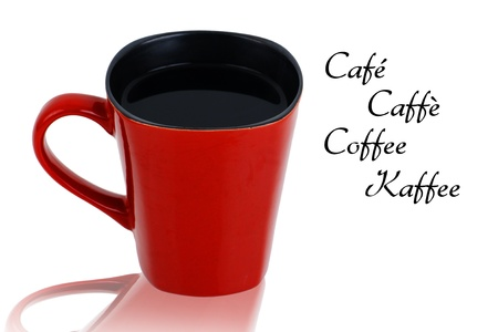 Red handcrafted square ceramic mug with black coffee and the word coffee in french, spanish, italien and german. photo