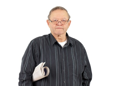 Portrait of a senior man with his reading glasses and rolled up newspaper under his arm. photo