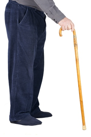 Profile of bottom half of an old man or elderly person walking with a wood cane, wearing blue corduroy and slippers, isolated on white. 版權商用圖片 - 11971496