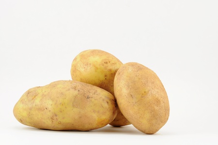 potatoe: Trio of potatoes on white background with copy space.