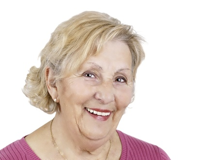 approachable: Portrait of a happy senior woman over white background, great details. Stock Photo