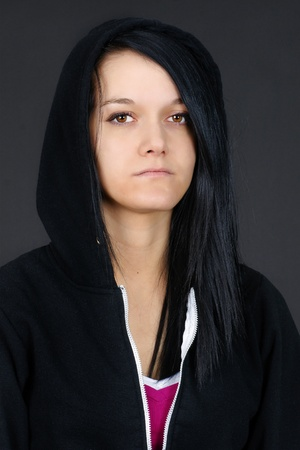druggie: Portrait of a young woman, teen or student looking sad or depressed, studio shot with black background.