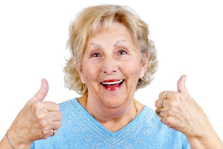 smile close up: Happy senior woman giving two thumbs up as sign of approval. Stock Photo