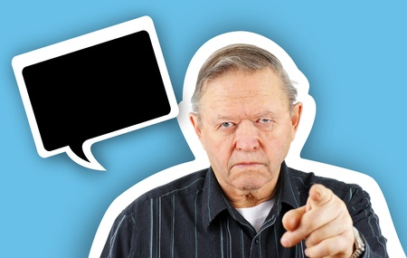 Grumpy angry senior or old man pointing his finger at the camera with a big frown on his face, blaming or warning in floating speech bubble with drop shadow. Stock Photo - 12855941
