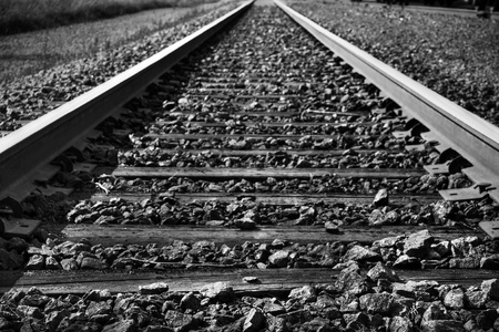 railroad track: Dramatic black and white rendering of train tracks with diminishing perspective, great background.