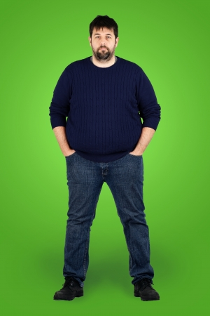 Complete body shot of a big guy looking at camera, real ordinary middle age bearded white man with weight problem in front of green screen, can be actor or extra.