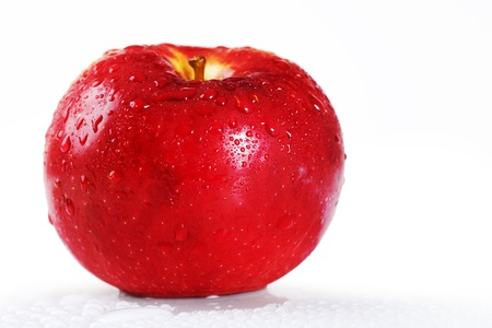 goodness: Beautiful studio shot of a fresh and wet red apple with water droplets dripping off it over white, perfect nutrition or diet background.