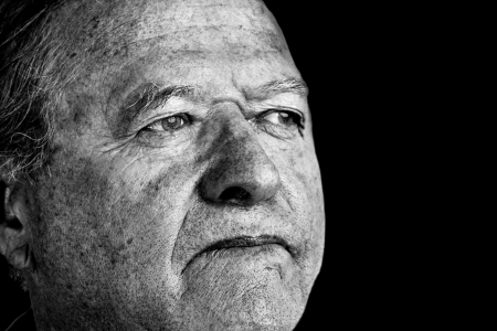 powerful man: Dramatic and powerful black and white portrait of a senior man with pale eyes