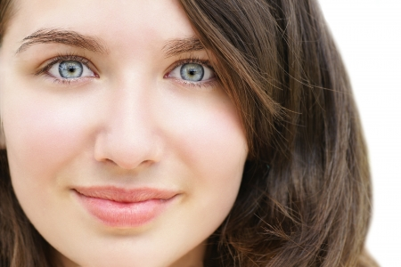 blue eyed: Portrait of a beautiful young woman, teenager or student with stunning light blue eyes and fare skin