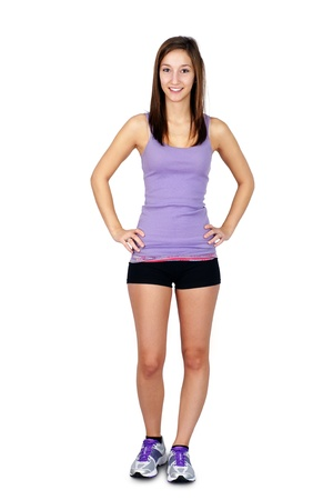 shit: Full body shit if a beautiful, healthy, sporty slim young brunette in work out clothes isolated on white background.