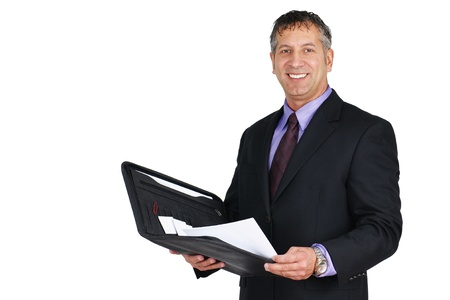 Man in suit and tie, holding paperwork and smiling, can be boss or management employee. photo