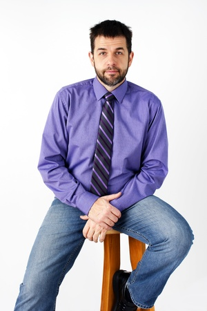 regular people: Middle aged caucasian man with short beard posing for photographer in studio over white background, can be actor or dating service.