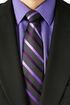 Close up of a businessman torso in dark grey or black suit with purple shirt and striped tie, great details of the textile.