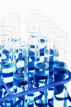 discovery: Macro of test tubes filled with blue liquid or chemical, great science, health or discovery background. Stock Photo