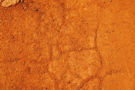 Typical tropical laterite soil, called red earth  because of the iron oxydation giving the rust color, great pedology or geology background. Stockfoto