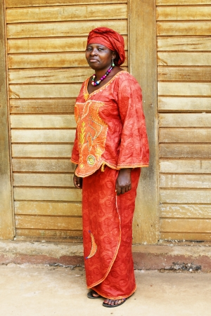developing country: Full body shot of mature African woman in traditional clothing or boubou