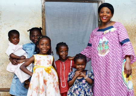 african fabric: Family with pregnant African woman with five daughters Stock Photo