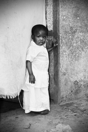 Dramatic black and white of African baby girl photo