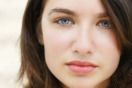 Beautiful but sad caucasian blue eyed brunette young woman