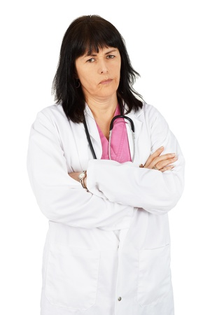 Middle age woman doctor with arms crossed, unhappy, on white Stock Photo - 19094094