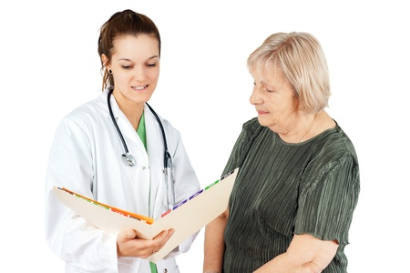 Young female doctor explaning test resutls to her senior woman patient photo