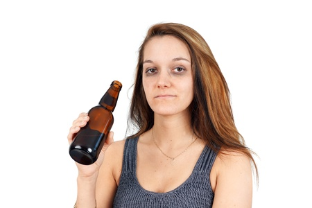 Drunk or alcoholic young woman with beer bottle on white photo