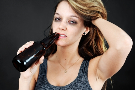 Beautiful young woman completely drunk or alcoholic photo
