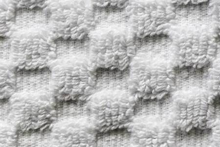 Macro shot of soft white towel with square pattern, black and white texture and background. photo