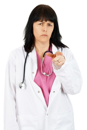 Unhappy or frowning woman doctor pointing her finger, blaming you photo