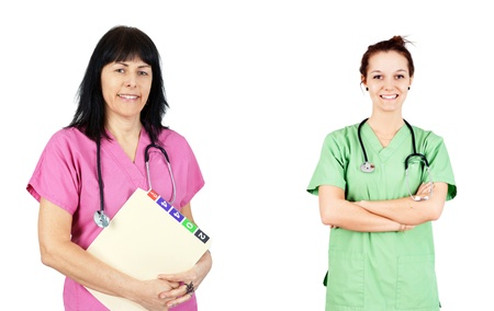 health care facilities: Friendly female doctors or nurses in pink and green scrubs isolated on white. Stock Photo
