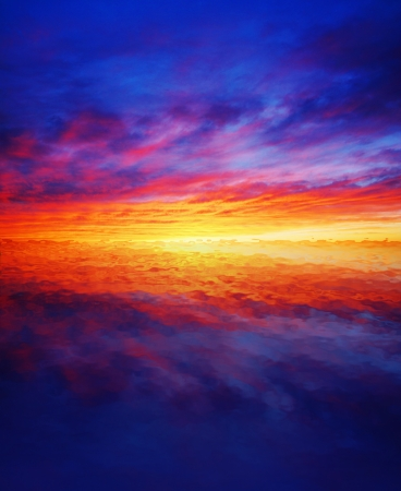 Beautiful colorful sunset reflected over water photo