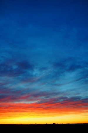 Vertical of beautiful colorful sunset over land photo