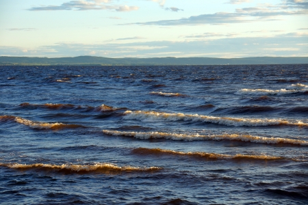 squall: Big waves on a lake before sunset