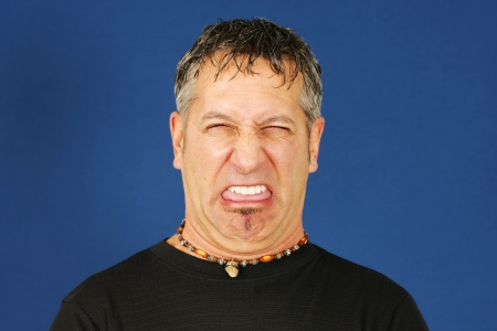 Man with funny disgusted face photo
