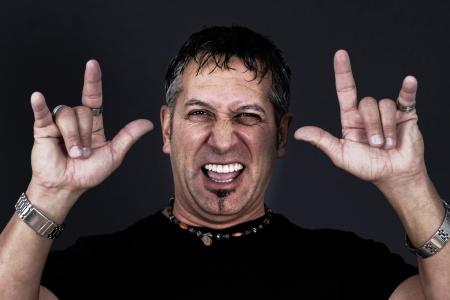Metal or biker guy making the devil gestures with his hands