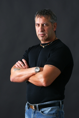 Serious or angry tough guy looking at camera Stock Photo