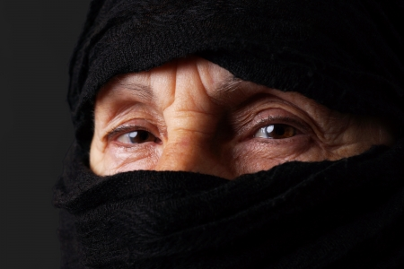 Eyes of senior muslim woman with niqab, looking at camera photo