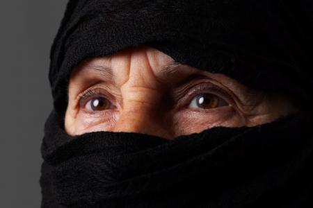 niqab: Eyes of senior muslim woman with niqab