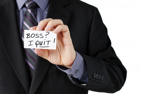 quit: Man hand holding a business card stating I quit in bold  Stock Photo