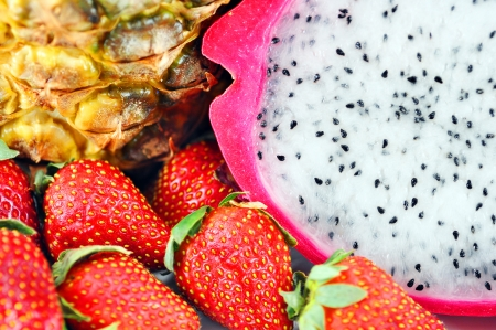 Fruit mix macro or background with dragon fruit, strawberries and pineapple