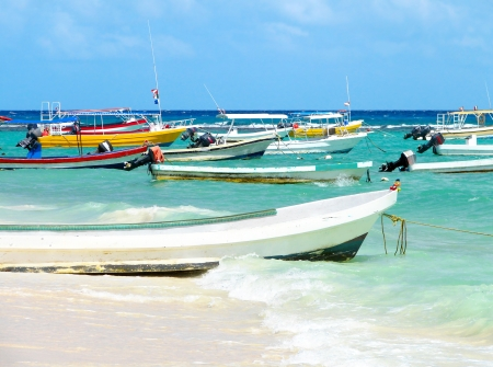 caribbean climate: Beautiful Carribbean sea and beach with fisherman and diver boats Stock Photo