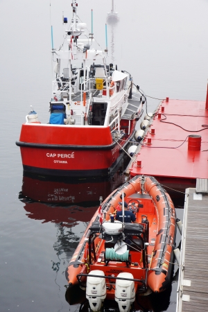 trafic: CANADA, QUEBEC, TADOUSSAC- AUGUST 8  Canadian coast guard vessel and zodiac docked at Tadoussac, Quebec, Canada on August 8, 2013  The Canadian coast guard is responsible for 2 3 million square nautical miles  8 million km2   Editorial