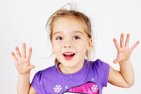 minx: Cute, mischievous little blond girl playing tricks