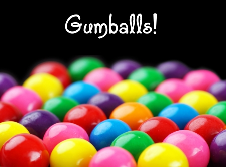 Fun and colorful gumballs on black background with text