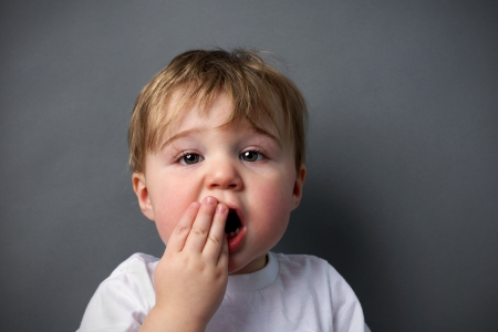 hurting: Little boy upset or hurting, toothache or other booboo concept.