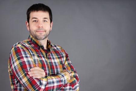 Confident, trustworthy, friendly middle-aged man, ordinary guy on grey